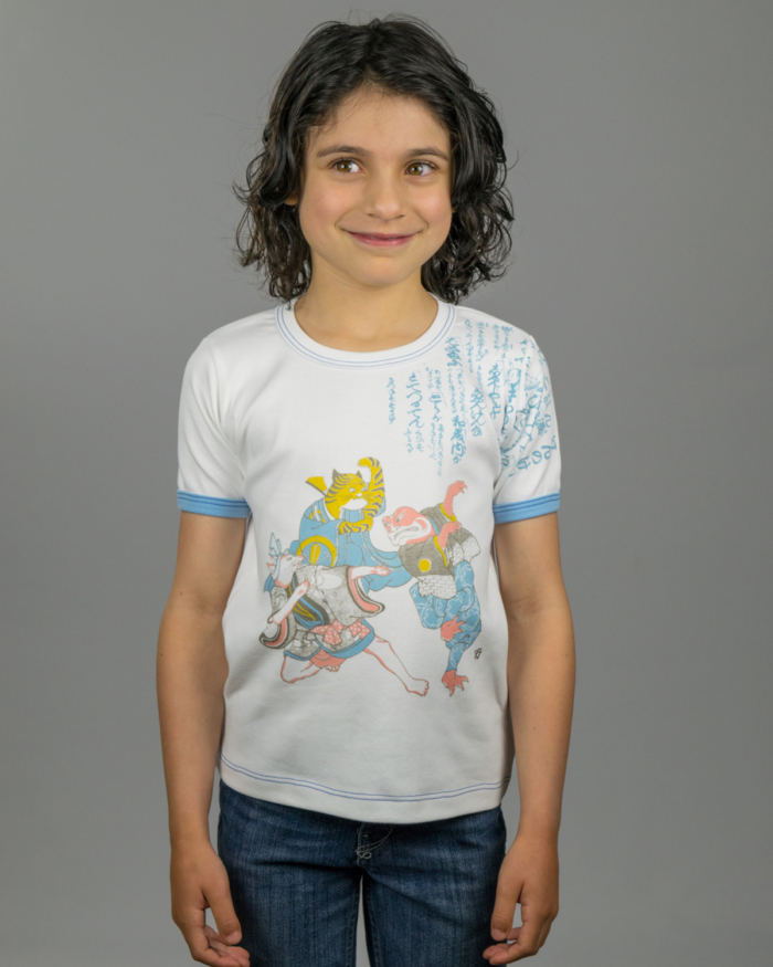 Image showing Ken kids t-shirt on girl model. Fox, Tiger and Frog playing hand game of Rock, Paper, Scissors.